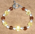 Bracelet made of Smoked Topaz and Jonquil crystal beads.